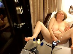 60+ GILF gets off in hotel room window