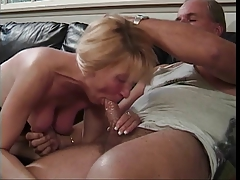 Blonde with gorgeous legs gives a blowjob
