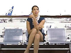 Sexy mature stewardess masturbates at the airport while waiting for her next flight