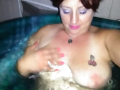 Trixie plays with her big Tits in hot tub