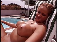 Busty blonde masturbates with huge dildo in the garden