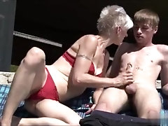 White Short Hair Old Lady Seducing Young Neighbor on the Beach