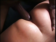 Dark haired white girl loves a huge black dick filling her ass outside