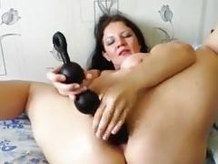 Mature toying her ass